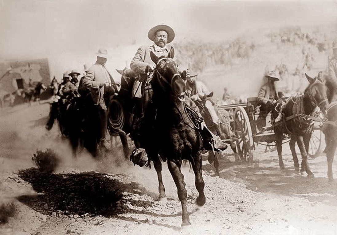 Pancho Villa riding a horse with troops